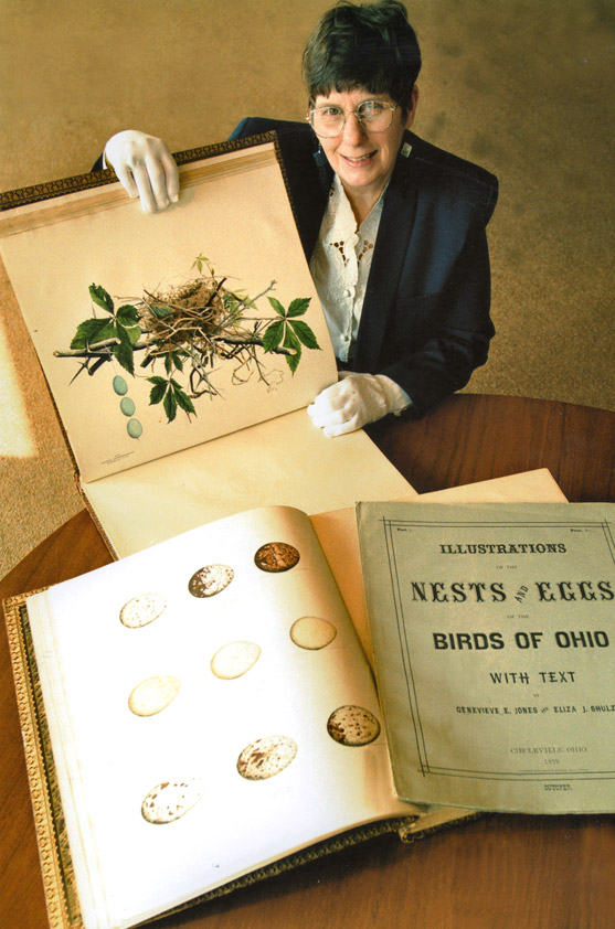 Joy Kiser holding bird book.