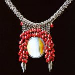 "Necklace by Tone Vigeland.  1978. Silver, agate, coral. 15"" length.