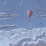 Image of a hot air balloon floating among clouds