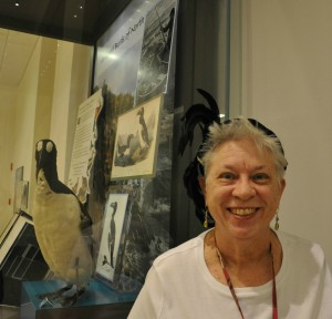 """Susan poses with her 1920s feathered hat near our """"Once There Were Billions"""" exhibition cases."""