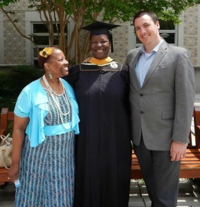 Salima poses with her mother and husband at her graduation from Catholic University.