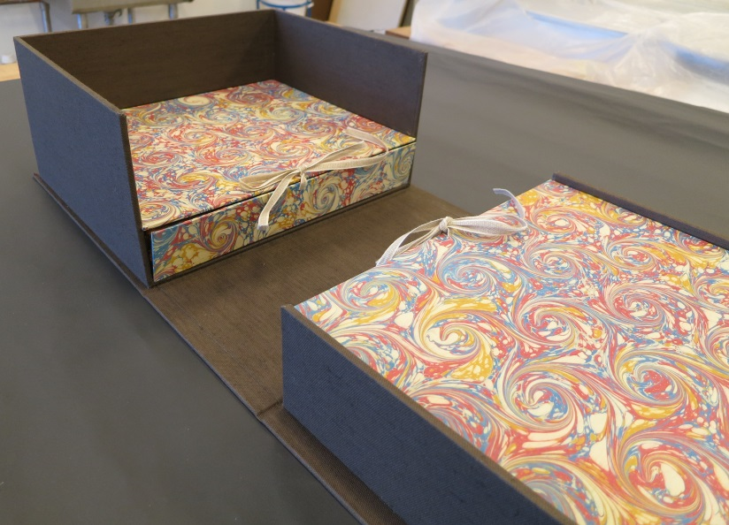 Marbled paper used to cover enclosures for completed treatment                                                                          of a 1704 edition of Opticks by Isaac Newton.                                                                                                            Dibner Library of Science and Technology