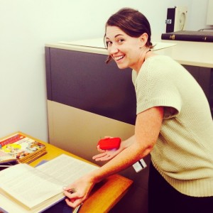 2014 Professional Development intern Kelly Baxter with Wonder Woman  manuscript materials.