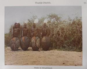 German East Africa: Maasai in war regalia.