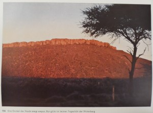The darkness of the night ascends. Waterberg [South Africa] glows red in the last daylight.