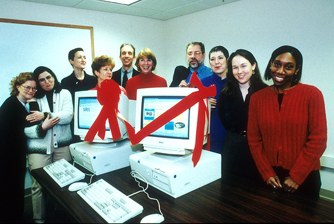 Staff celebrate the debut of the Smithsonian Institution Research Information System in 1999.