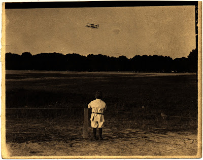 Carl H. Claudy Jr. watching the Wright Military Flyer during the Army Trials at Fort Myer, 1908. Photograph by C.H. Claudy, National Air and Space Museum Archives
