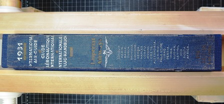 Original spine label trimmed and adhered