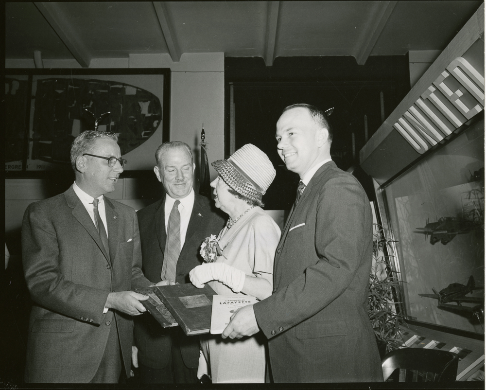 Presentation of the Journal de Marches et Operations of the Lafayette Escadrille by Georges Thenault to the Smithsonian Institution, National Air Museum, April 19, 1963. Left to Right: Mr. James Bradley, Col. Charles H. Dolan, II, Madame Thenault, Mr. Georges Thenault.