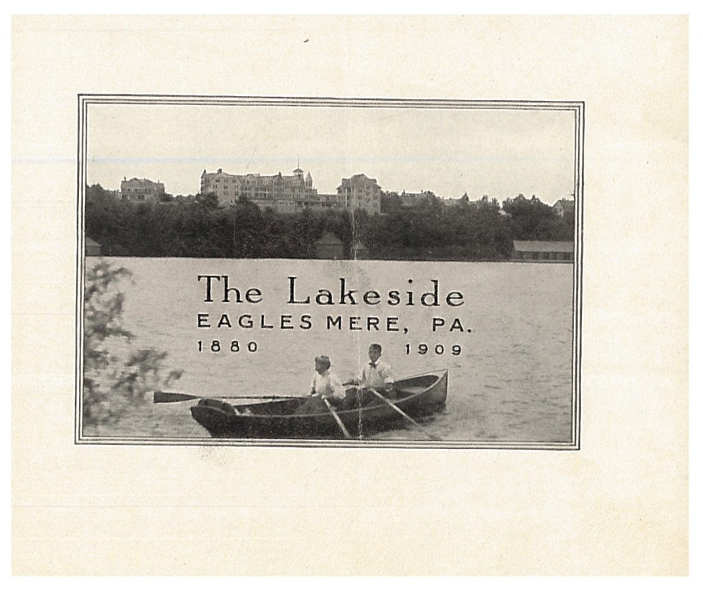 two people on a rowboat with Lakeside in the background