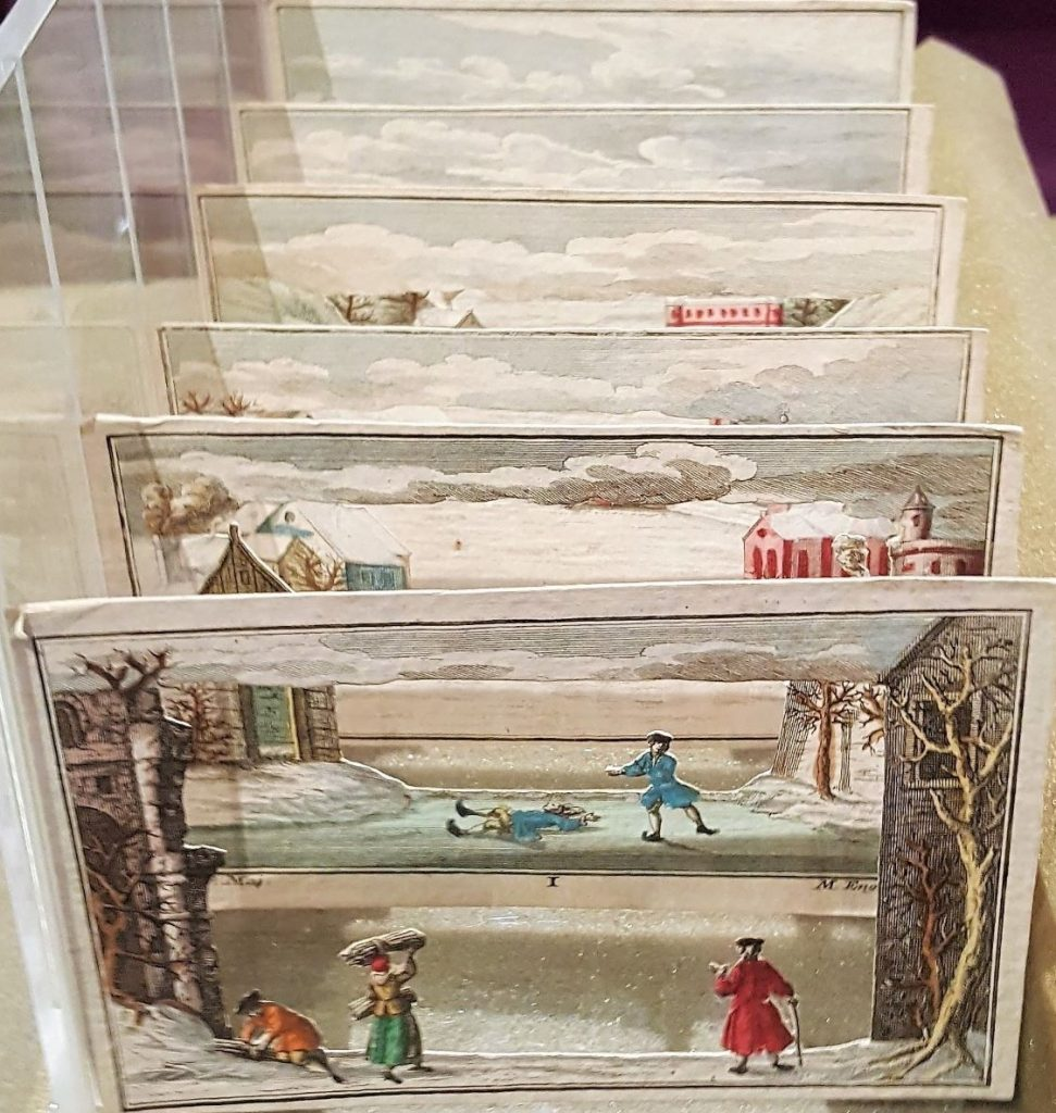 This image features Individual cut-out plates of Winter Scene by Martin Engelbrecht displayed in a viewing stand.
