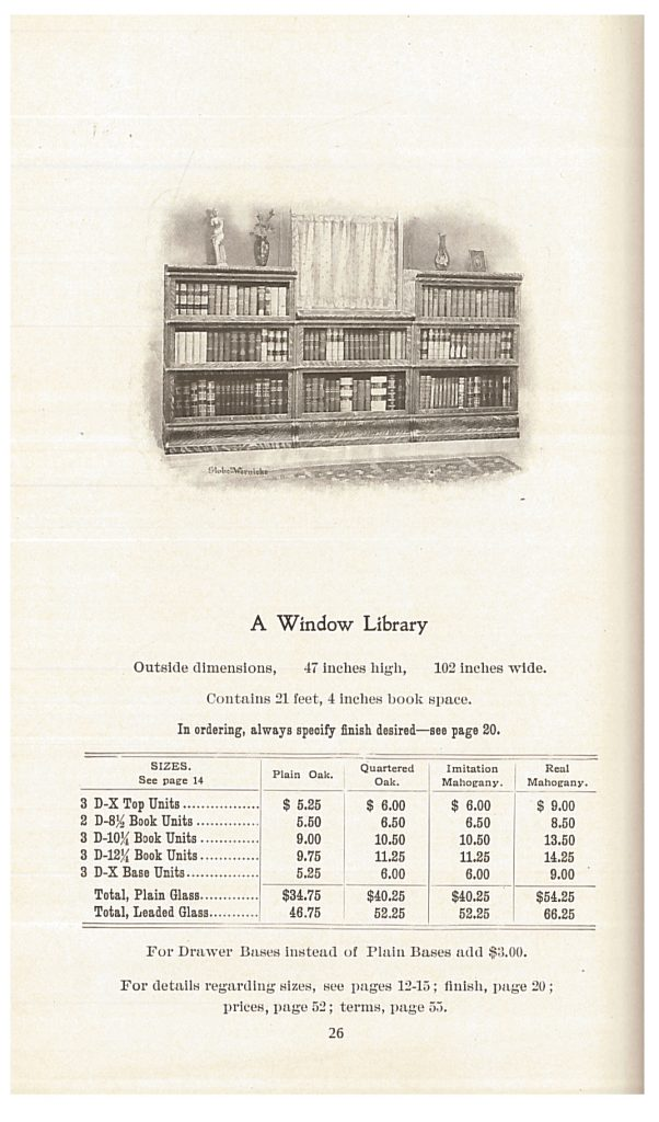 three bookcase units placed to fit around a window in a library