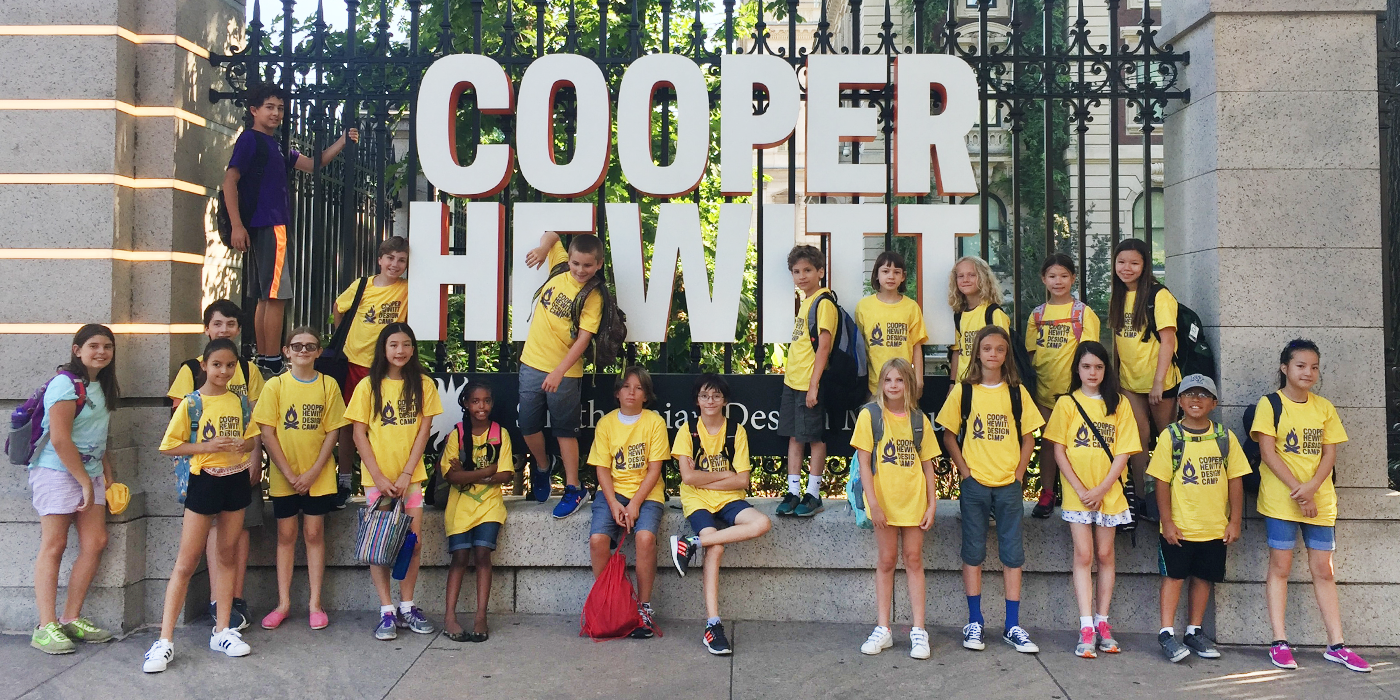 This images features a group of Design Campers wearing their camp tee shirts posing outside the museum.