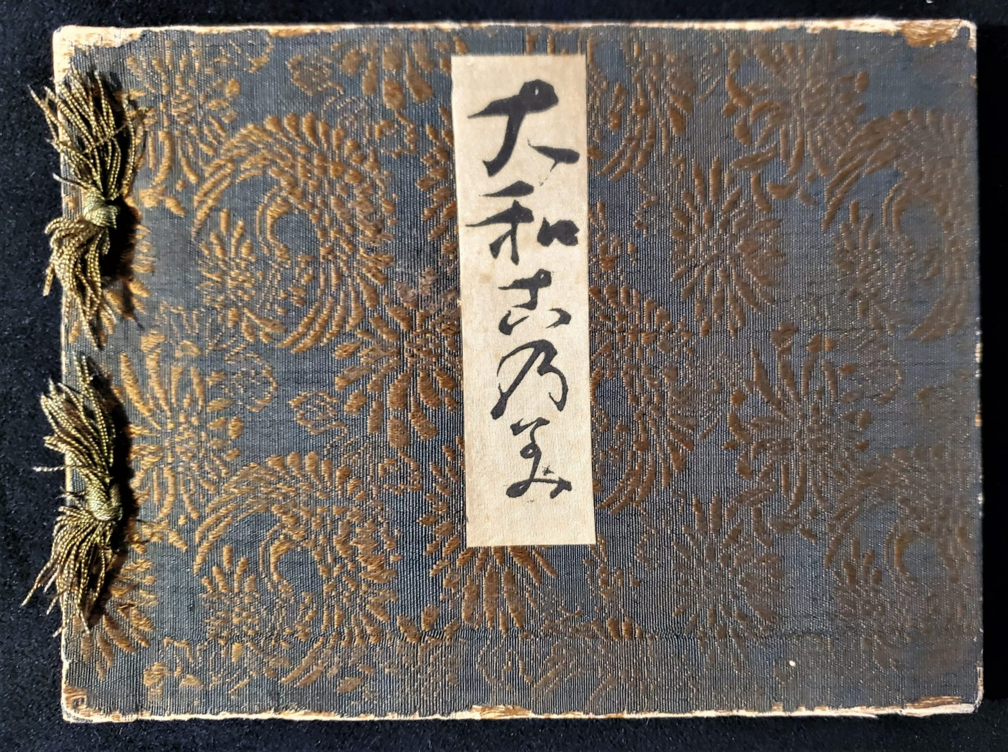 Cover of 1905 Yamanaka & Co. furnishings trade catalogue. Covered in silk brocade and bound with silk threads according to the ancient Japanese bookbinding technique of Yotsume Toji or stab-binding.