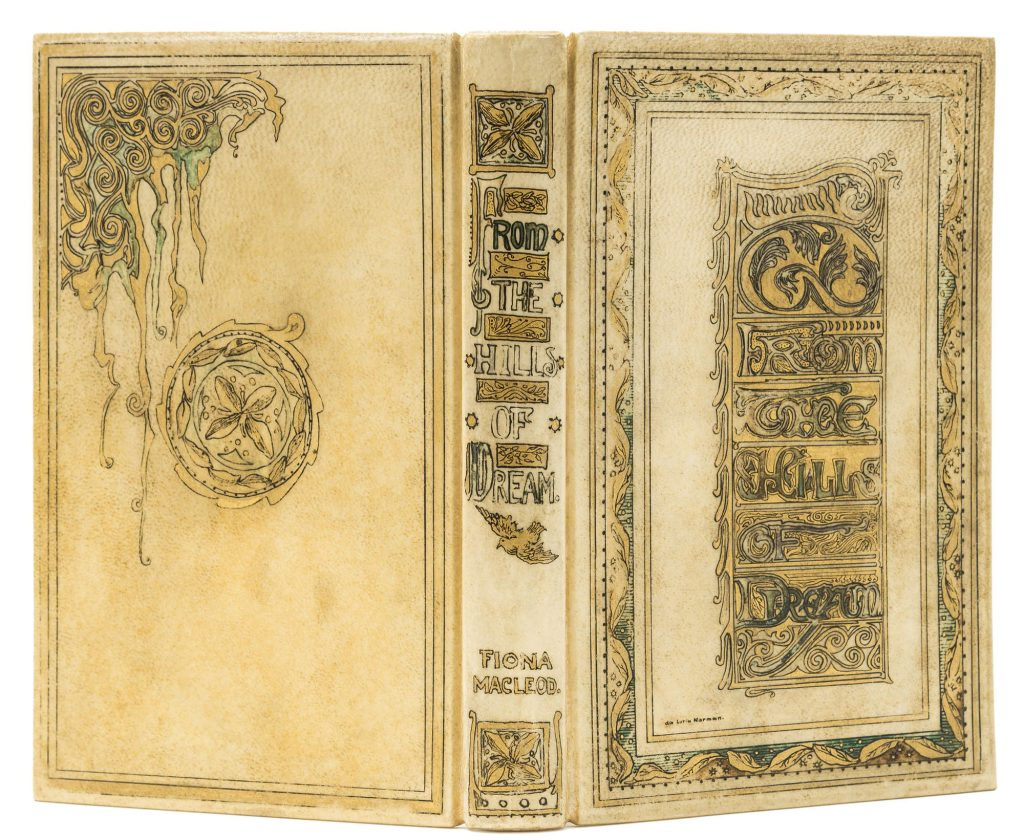 Opened book with ornate white velum binding.