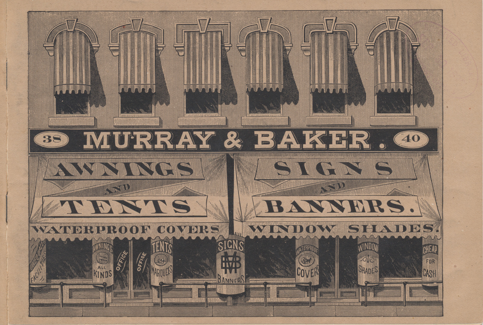 two floor building with awnings over windows and signs on display windows