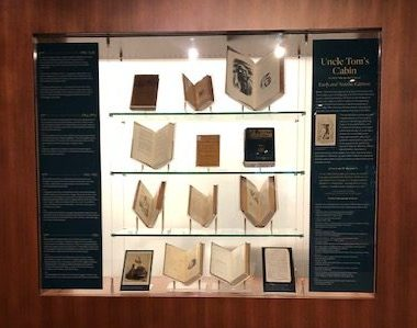 Photo of books on display in lighted case.