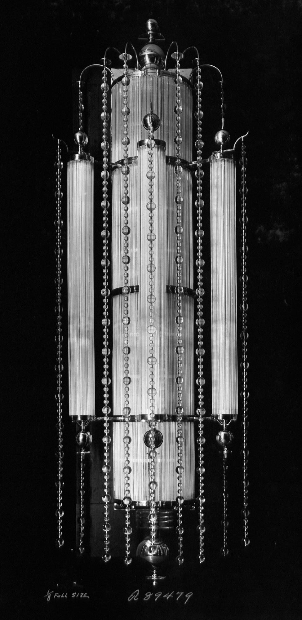Black and white photograph of long Art Deco-style light fixture.