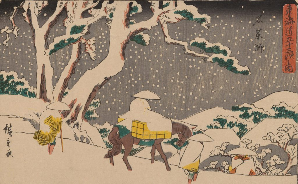 Japanese woodblock print of snowy scene. One figure on horseback, three on foot, walk beneath a snow covered tree.