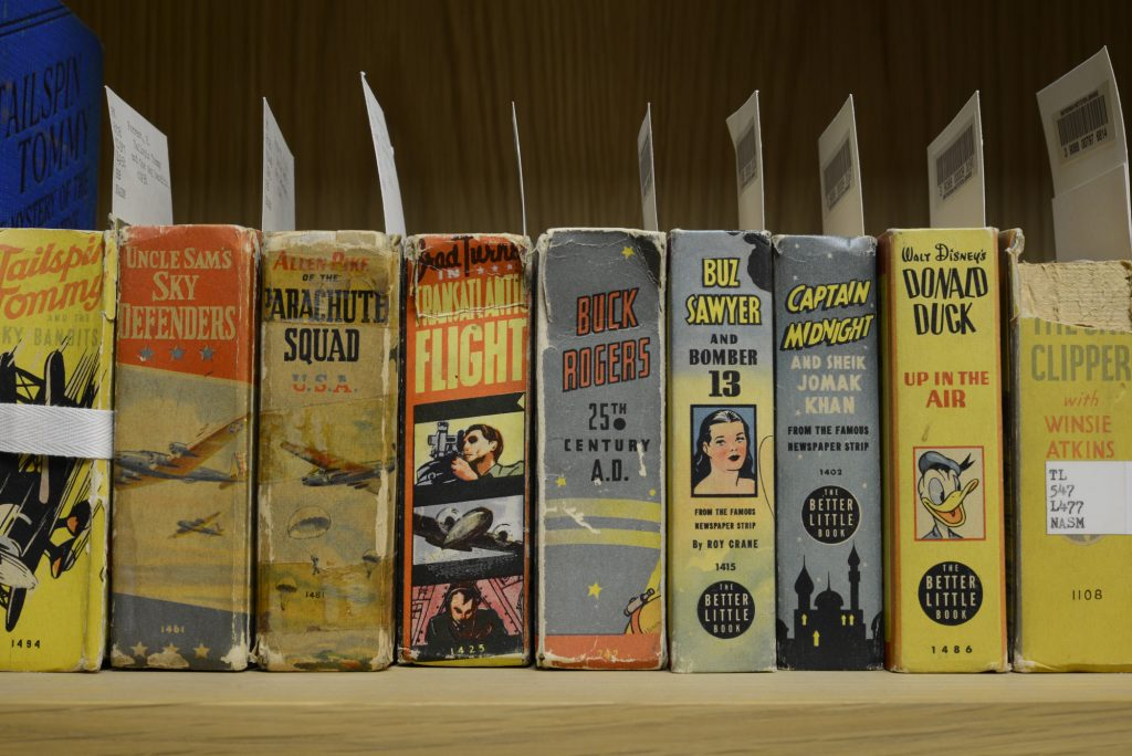 Photograph of 20th century book spines.