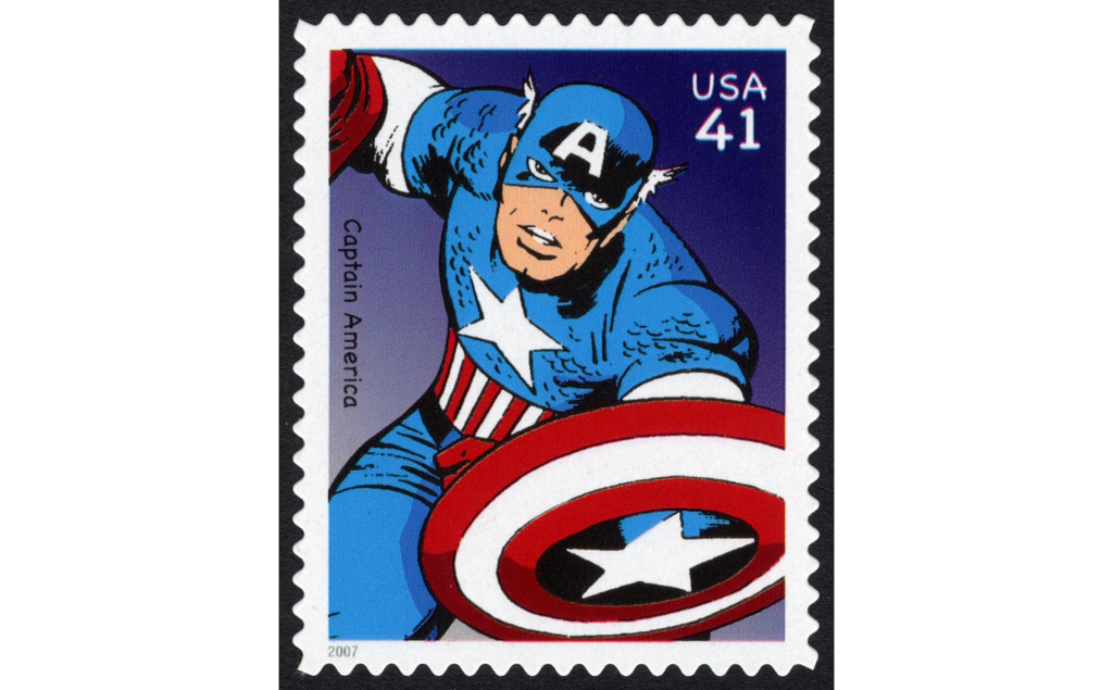 Postage stamp featuring comic drawing of Captain America with shield.