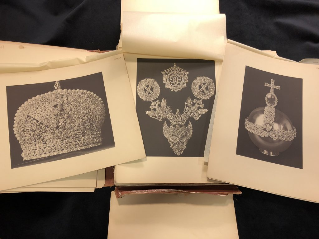 Early 20th century book with loose photographic plates. Plates illustrate three sets of jewels.